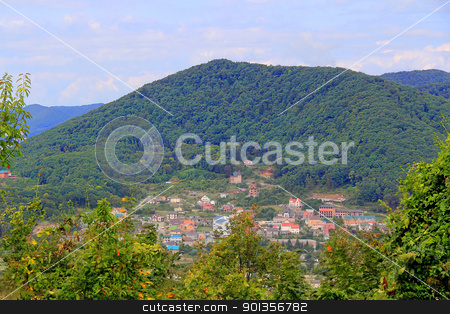 Landscape with Caucasus mountains and small town stock photo, Summer landscape with Caucasus mountains and small town by Julialine