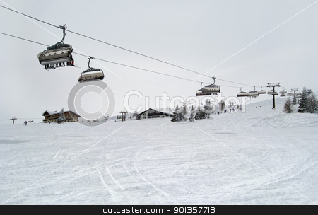 ski lift in Wagrain stock photo, Winter scenery in Wagrain (Austria) with ski lift and lots of snow in cloudy ambiance by prill