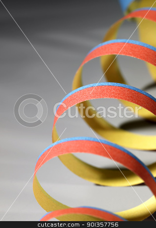 streamer detail stock photo, symbolic carnival background showing the detail of a paper blow-out in grey back by prill