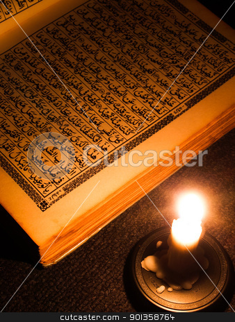 Al Qur'an stock photo, Al Qur'an and candle light. by indonesian image