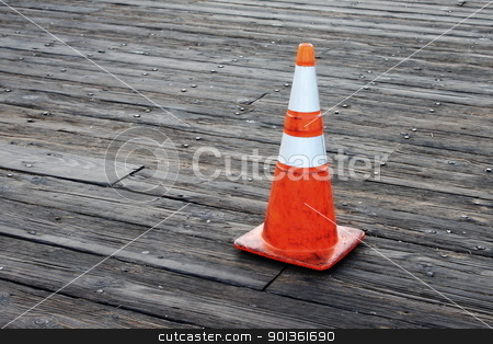 Warning Cone stock photo, Red orange warning cones on wooden pier by Henrik Lehnerer
