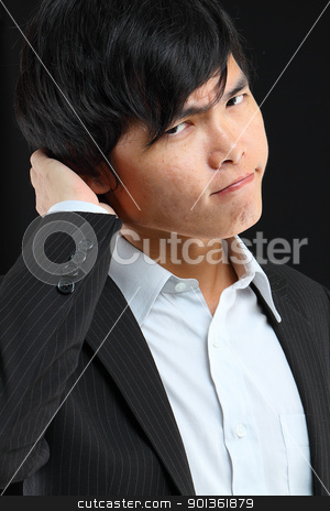 Executive standing with concerned look  stock photo, Executive standing with concerned look  by Keng po Leung