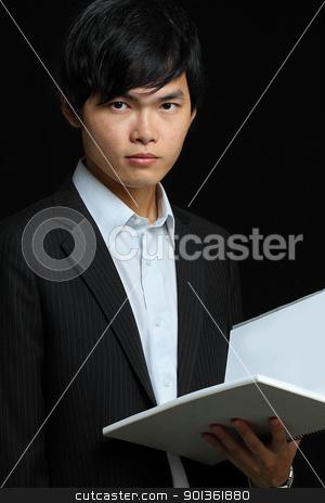 asia man holding folder stock photo, asia man holding folder by Keng po Leung