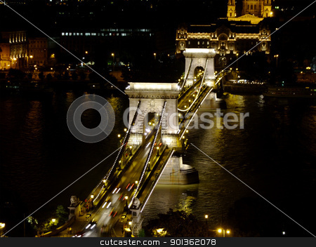 Szchenyi Chain Bridge in Budapest by night stock photo, Szchenyi Chain Bridge in Budapest was designed by the English engineer William Tierney Clark in 1839.  In World War II, the bridge was damaged, and it needed to be rebuilt. The rebuilding was completed in 1949. by Massimiliano Pieraccini