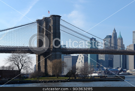 Brooklyn Bridge and New York stock photo, city view of New York (USA) behind the East River and Brooklyn Bridge in sunny ambiance by prill