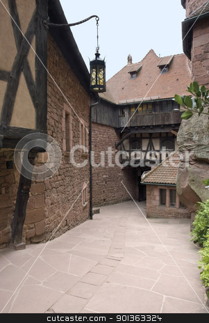 courtyard at Haut-Koenigsbourg Castle stock photo, architectural detail around the courtyard of the Haut-Koenigsbourg Castle, a historic castle located in a area named Alsace in France by prill