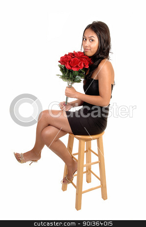 Pretty girl with roses. stock photo, A beautiful and slim Asian woman sitting on a chair with a bunch of red roses in her hand, in a black dress and heels for white background.  by Horst Petzold