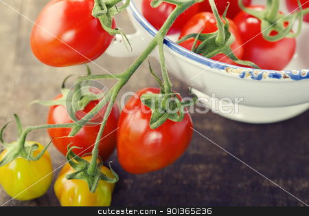 cherry tomatoes stock photo, branch of organic cherry tomatoes on a blue plate by klenova