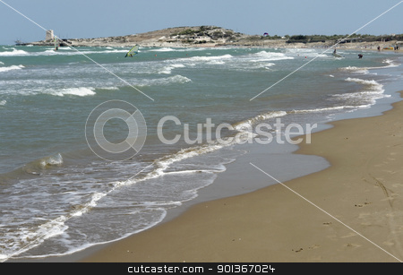 sunny beach and surfers stock photo, coastal holiday scenery showing a beach in Southern Italy by prill