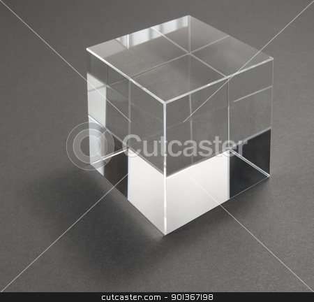 glass cube and reflections stock photo, studio photography of a glass cube in grey back by prill