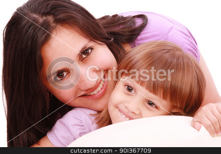 Mother and daughter posing happily in bed stock photo, Mother and daughter posing happily in bed by dacasdo