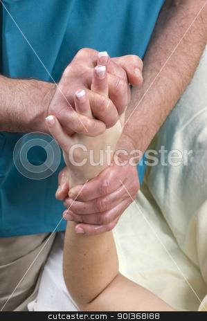 Woman having Massge  stock photo, Woman getting a hand Massage from a massuer by Jeffrey Banke