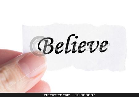 Believe word in finger stock photo, Believe word in finger, word on piece tear paper  by Lawren