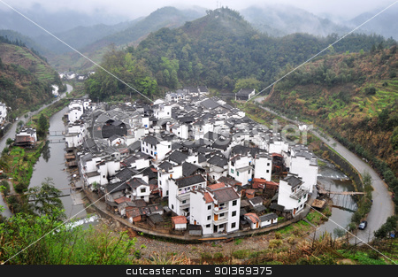 Traditional Chinese village stock photo, Landscape of a traditional Chinese village surrounded by a river and mountains by John Young