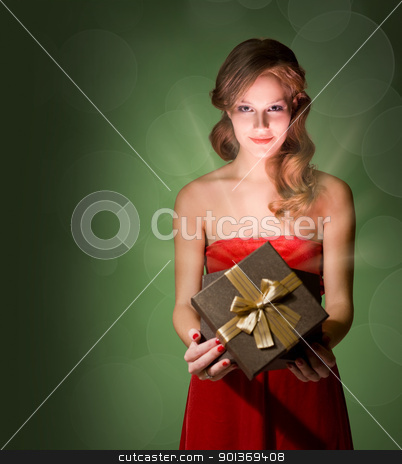 Beautiful blond holding gift box. stock photo, Half length portrait of beautiful blond holding gift box with creative lighting. by exvivo