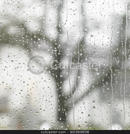 rainy detail in blurry back stock photo, detail of roll off raindrops on window glass by prill