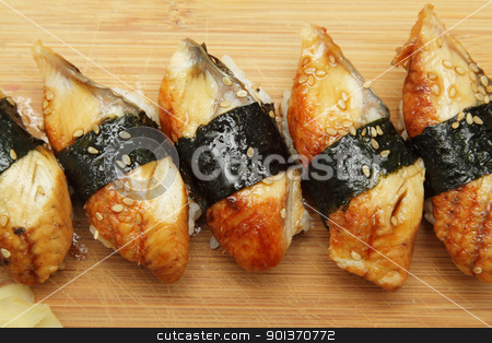 Eel sushi stock photo, Group of broiled eel (unagi) sushi with sesame seeds by Olena Pupirina