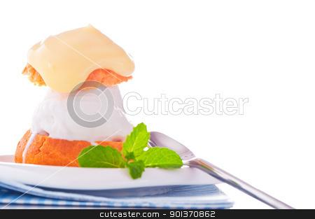 Profiterole in a small plate with ice cream vanilla sauce and mi stock photo, Profiterole in a small plate with ice cream vanilla sauce and mint leaf on a white backgound by p.studio66