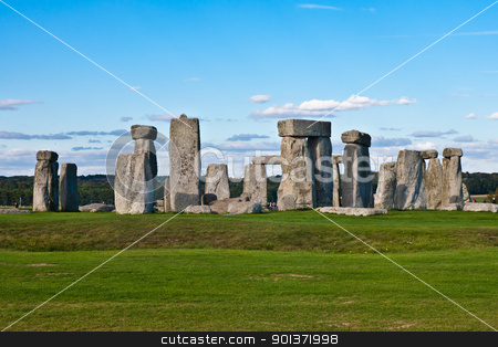 Stonehenge stock photo, The ancient UNESCO World Heritage Site at Stonehenge on Salisbury Plain in Wiltshire, UK, with its massive standing stones under deep blue sky by pawelkowalczyk