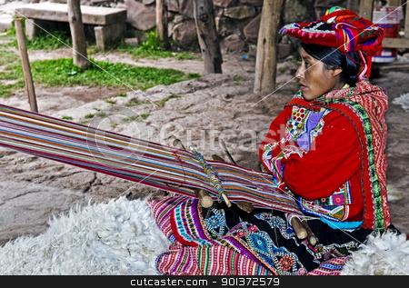 Peruvian woman weaving stock photo, Cusco , Peru - May 26 2011 : Quechua Indian woman weaving with strap loom by Kobby Dagan