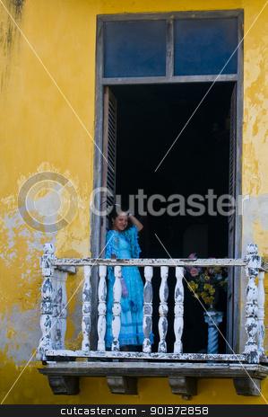 Cartagena de Indias stock photo, Catagena de Indias , Colombia - December 21 2010 : Girl in a balcony in  an old house  by Kobby Dagan