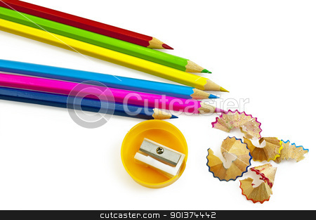 Colored pencils with sharpener stock photo, Blue, pink, yellow, green, maroon pencils, pencil sharpener and a yellow color chips isolated on a white background by rezkrr