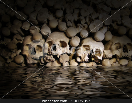 Skulls and bones from charnel-house stock photo, Skulls and bones from charnel-house in the water by orson