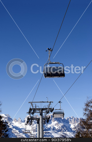 Ski lift  stock photo, Ski lift chairs on bright winter day in Trentino, Italy by freeteo