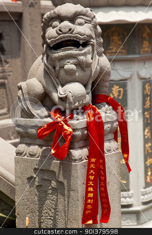 Stone Dragon Red Ribbons Jade Buddha Temple Jufo Si Shanghai Chi stock photo, Stone Dragon Red Ribbons Buddhist Sayings Jade Buddha Temple Jufo Si Shanghai China Most famous buddhist temple in Shanghai by William Perry