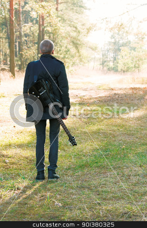 musician stock photo, teen musician with a guitar in the autumn forest by Salauyou Yury