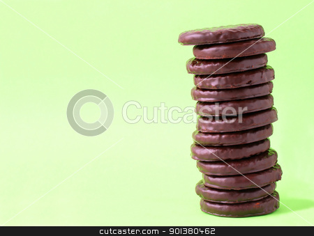 Cookies stock photo, Chocolate biscuits on a light green background by Mykola Komarovskyy