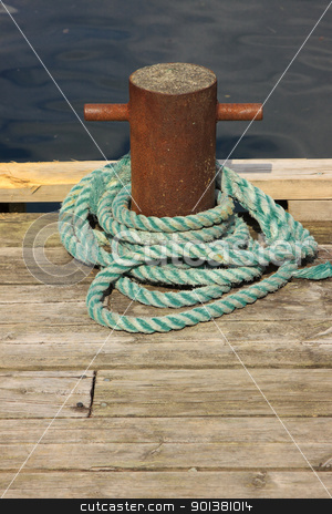Rope for mooring a boat to a pier stock photo, Rope for mooring a boat to a pier by Chretien