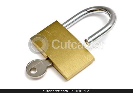 Padlock and key stock photo, Padlock and key isolated on white background   by Sasas Design