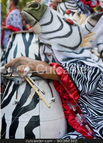 Candombe stock photo, MONTEVIDEO,URUGUAY-FEBRUARY 5 2011: Candombe drummer in the Montevideo annual Carnaval ,  Candombe is a drum-based musical style of Uruguay. Candombe originated among the African population in Montevideo Uruguay by Kobby Dagan