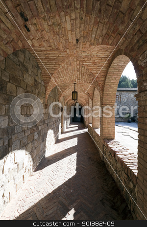 Stone Corridor stock photo, A stone corridor leading one around a courtyard by Kevin Tietz
