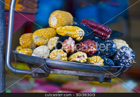 Corn stock photo, Different types of corn on a market in Peru by Kobby Dagan