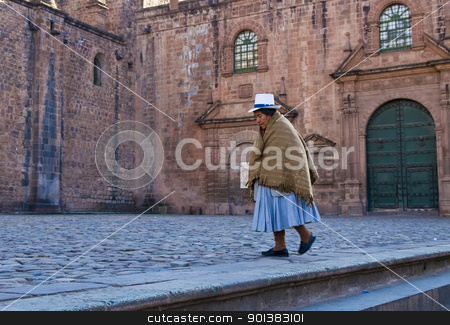 Peruvian woman stock photo, Cusco , Peru - May 29 :  Peruvian woman walk near the Cusco cathadral by Kobby Dagan