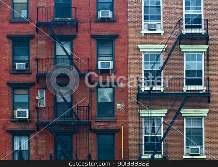 Building in New York stock photo, A fire escape of an apartment building in New York city by Kobby Dagan