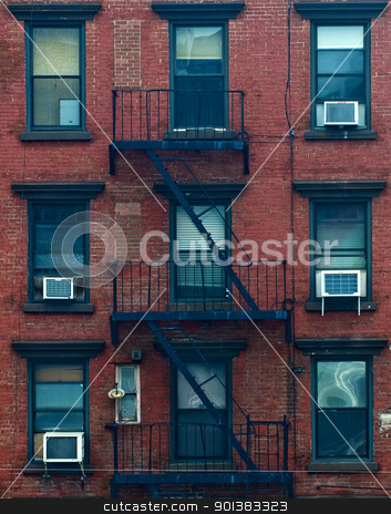 Building in New York stock photo, A fire escape of an apartment building in New York city by Kobby Dagan