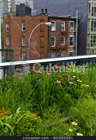 High line park in New York stock photo, An apartment building and the elevated high line park in Manhattan New York  by Kobby Dagan