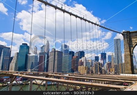 Brooklyn bridge stock photo, View of Manhattan from the Brooklyn bridge  by Kobby Dagan