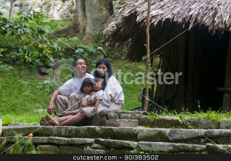 Indian family stock photo, TAYRONA PARK , COLOMBIA - DECEMBER 17 2010 : Indian family sit together at home in a village in