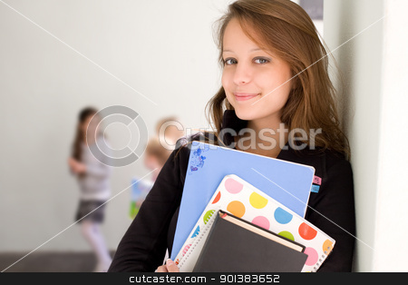 Beautiful smiling young student. stock photo, Half length portrait of a beautiful smiling young student with exercise books. by exvivo