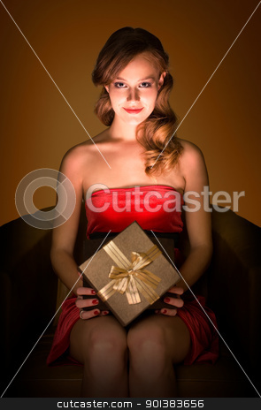 Magical gift. stock photo, Portrait of beautiful smling realxed young blond with magical gift box. by exvivo