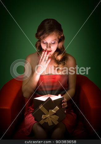 Surprise gift. stock photo, Portrait of beautiful suprised young blond with magical gift box. by exvivo