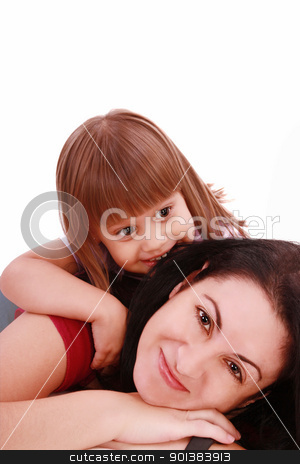 A portrait of a mother and her baby girl lying on the floor and  stock photo, A portrait of a mother and her baby girl lying on the floor and smiling over white background   by dacasdo