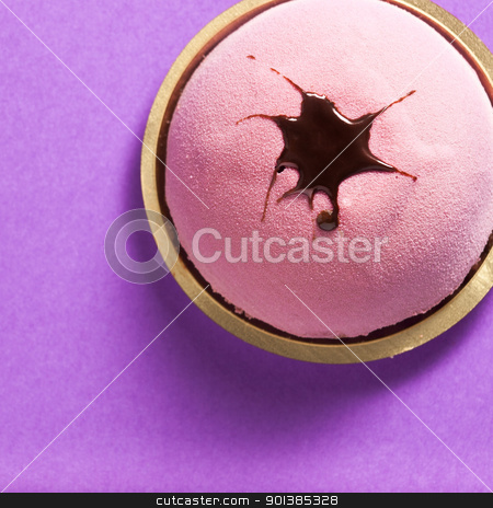 Round Strawberry Pastry stock photo, Close-up photograph of a round strawberry pastry set on a purple background by mpessaris