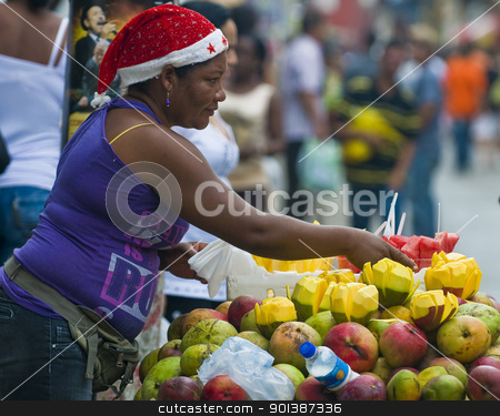 Colombian fruit seller stock photo, CARTAGENA DE INDIAS , COLOMBIA - DEC 21:Unidentified colombian woman sell fruits in the street of Cartagena de Indias on December 21 2010 by Kobby Dagan