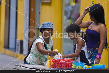 Colombian fruit seller stock photo, CARTAGENA DE INDIAS , COLOMBIA - DEC 21:Unidentified colombian woman sell fruits in the street in Cartagena de Indias on December 21 2010 by Kobby Dagan