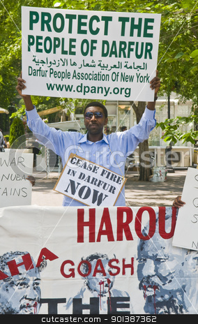 Sudan demonstration  stock photo, NEW YORK -  JUNE 27 2011 : Unitentified participant in a demonstration against the government of Sudan in front of the UN offices in New York city on June 27 2011 by Kobby Dagan